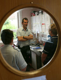 Dementia Nurse in discussion with NHS colleagues