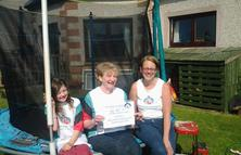 Caption: Sarah's sponsored trampoline event raised money and awareness of our work