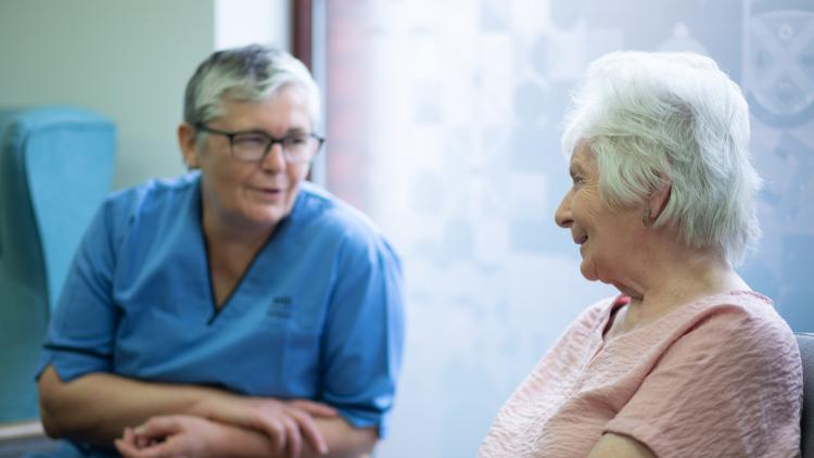 Conversation between NHS worker and person with dementia