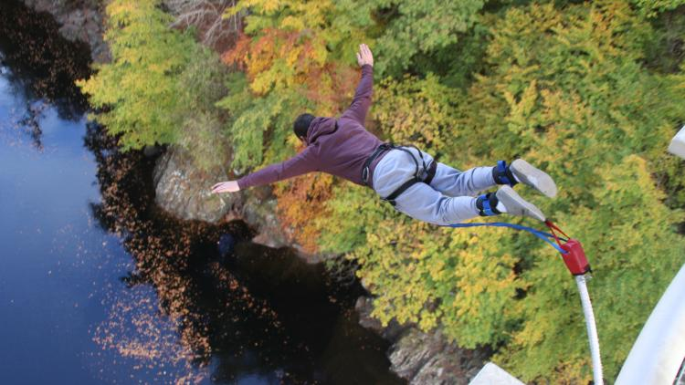 A man bungee jumps