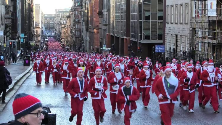 Runners dressed as Santa run through Glasgow