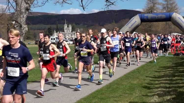 Participants run with Balmoral Castle in the background