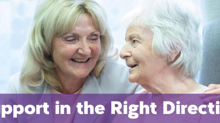 Support in the Right Direction - Two women, one with an arm around the other smile together.