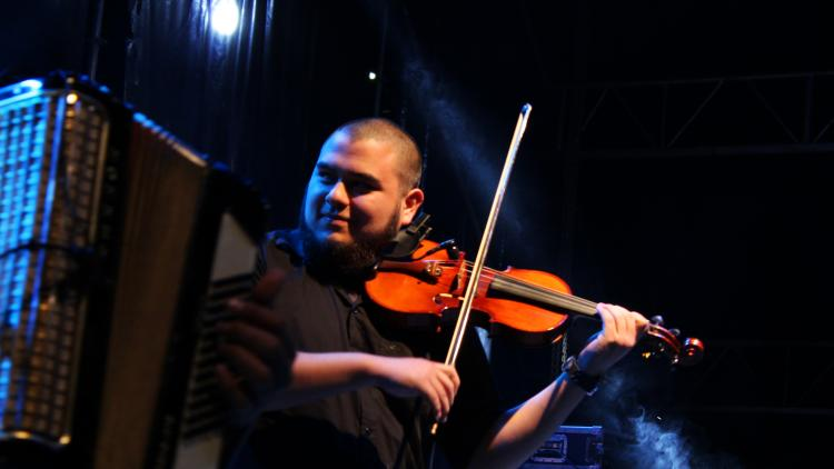 Violinist playing on stage