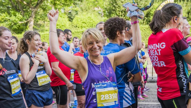 A woman celebrates after running for Alzheimer Scotland